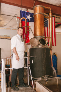 Quentin Witherspoon stands next to his reflux column still inside his distillery at 545 N. Cowan Ave., Ste. F in Lewisville. You can find his River Rum and Texas Straight Bourbon Whiskey in select liquor stores around the metroplex. Photo by Edward Balusek / Staff Photographer