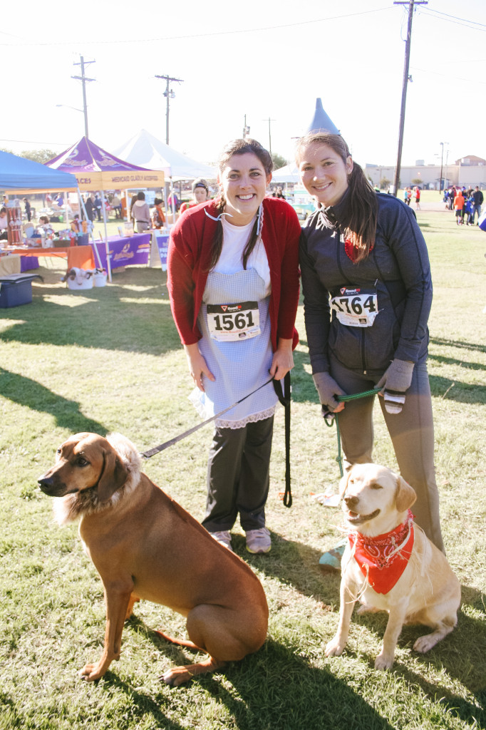 Allison Flannigan, Jessica Killion and their dogs Ziggy and Kaia are dressed in Wizard of Oz-themed costumes. They participated in the costume contest at the end of the running events. Photo by Shelby Adelsen / Contributing Photographer