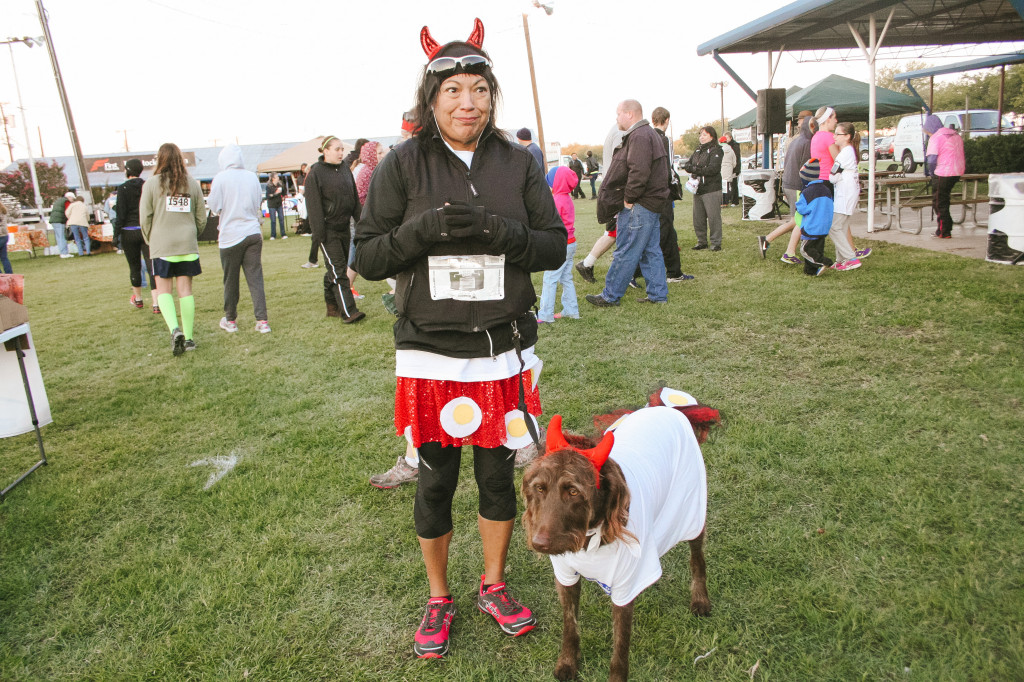Dressed as deviled eggs, Theresa Tucker and her dog Nina are ready to participate in the costume contest that was held at the end of the event. Nina is a diabetic service dog. Photo by Shelby Adelsen / Contributing Photographer