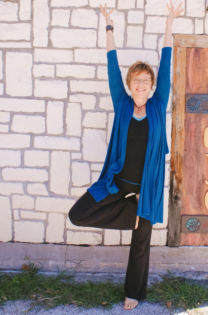 Becky Klett does the tree pose outside the Denton Yoga Center. Photo by Larissa Mathews / Intern Photographer