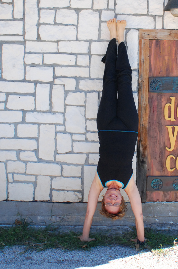 Klett does a yoga headstand outside the Denton Yoga Center. Photo by Larissa Mathews / Intern Photographer