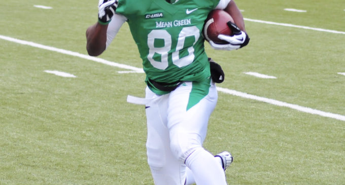 UNT football smothers Tulsa 42-10 for eighth win