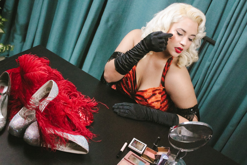 Fashion design senior Iliana Vera applies some blush to her face as part of her burlesque dancer costume. Iliana works as a makeup artist at Ulta in Denton at the Benefit Cosmetics brow bar. Photo by Harris Buchanan / Staff Photographer
