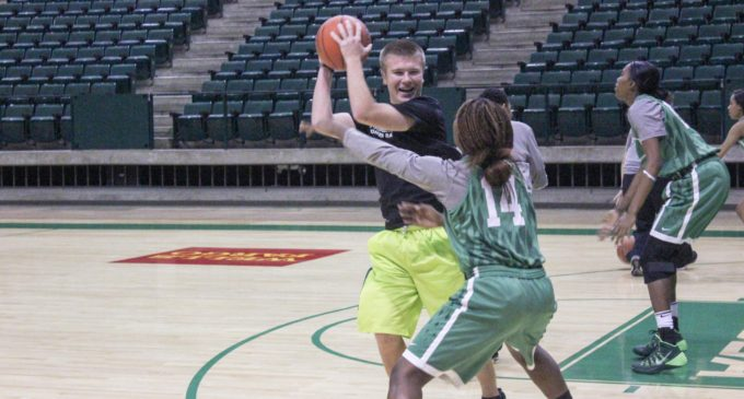 Students fill crucial behind-the-scenes role for basketball teams