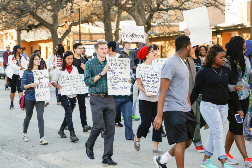 Members of the UNT community march from Willis Library to the MLK Center to celebrate MLK Day on Monday. Photo by Zixian Chen / Senior Staff Photographer