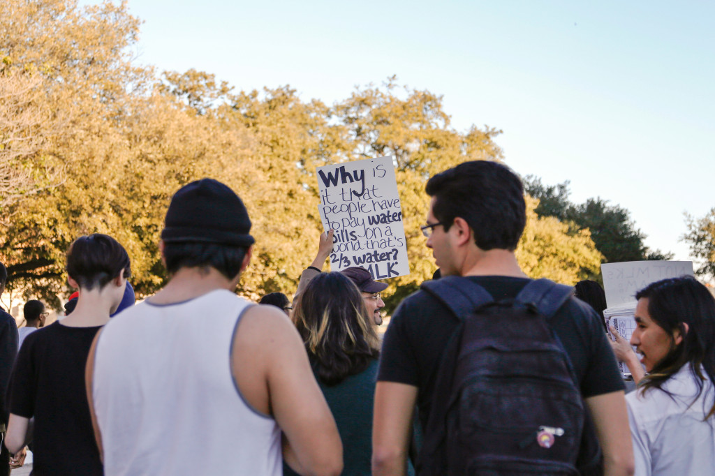 Many UNT community members made signs to hold while walking during the march. One protest sign in particular addressed the current water issue. Photo by Zixian Chen / Senior Staff Photographer