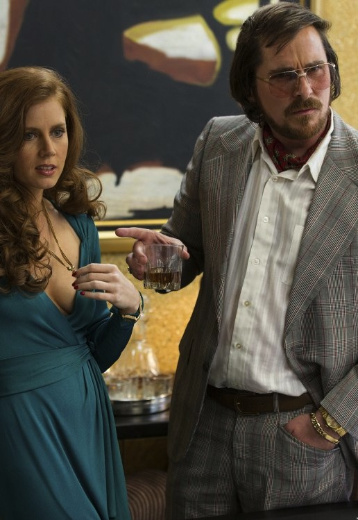 """Amy Adams and Christian Bale picked up nominations for their performances in """"American Hustle."""" Photo courtesy of Columbia Pictures."""