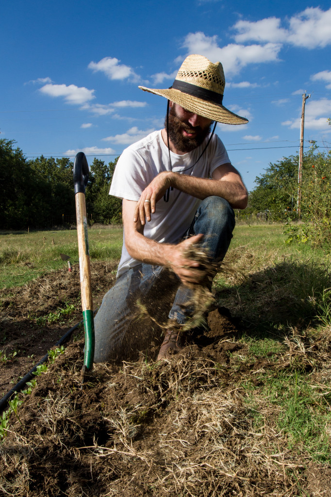 Jubilee Farms owner Ben Chessman pulls out weeds near his crops. Photo by James Coreas / Contributing Photographer
