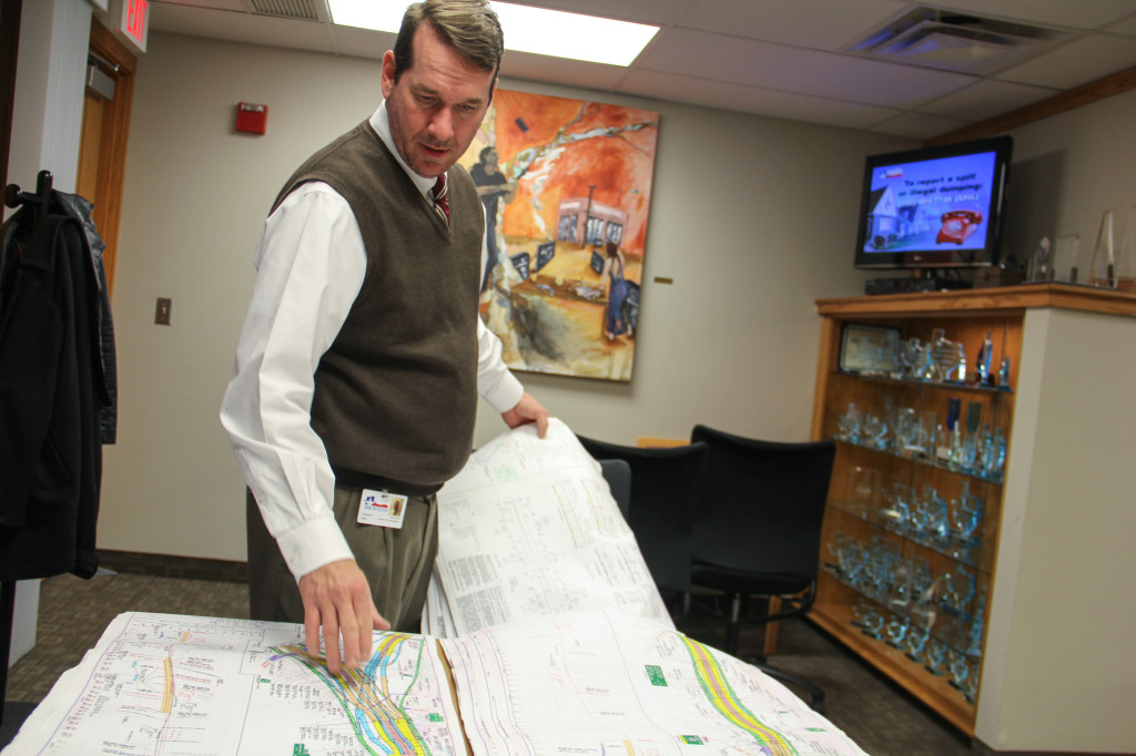 Mark Nelson, Director of Transportation for the City of Denton, is seen here getting hands on with the schematic layouts for the new construction plans. Photo by Zach Estrada / Intern Photographer