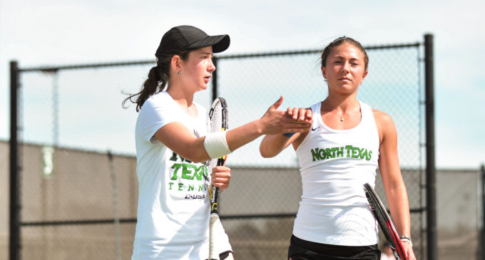 Tennis team overcomes stormy weather in season opening tournament