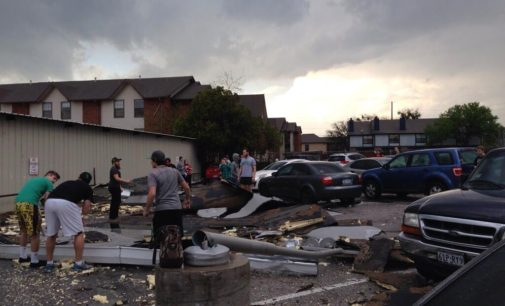 """Video: Students take cover from """"golf ball-sized"""" hail storm, damage reported"""