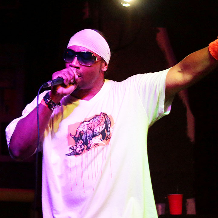 Rapper KING GI performs on stage at Andy's Bar Friday night for Oaktopia