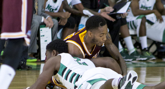 Men's basketball loses first game of season