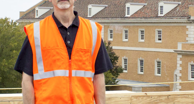 Roofing consultant works on new Union