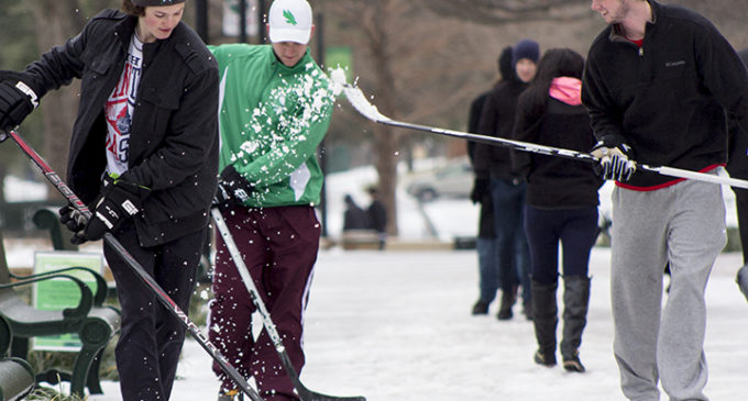 Ice and sleet make Denton a chilly playground