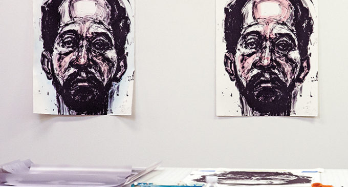 Visiting artist uses portraits for social comment