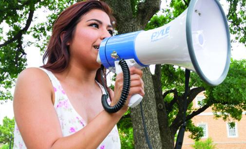 Protestors argue Abbott as graduation speaker