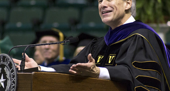 Light crowd, small Abbott protest at mass commencement