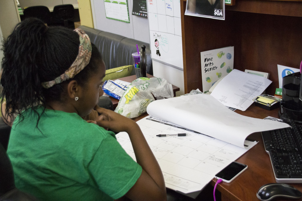 Broadcast journalism junior and SGA director of campus outreach Mikayla Barnes looks at a calendar as she plans events for the upcoming fall semester on Wednesday, August 27, 2015. Dylan Nadwodny   Intern Photographer