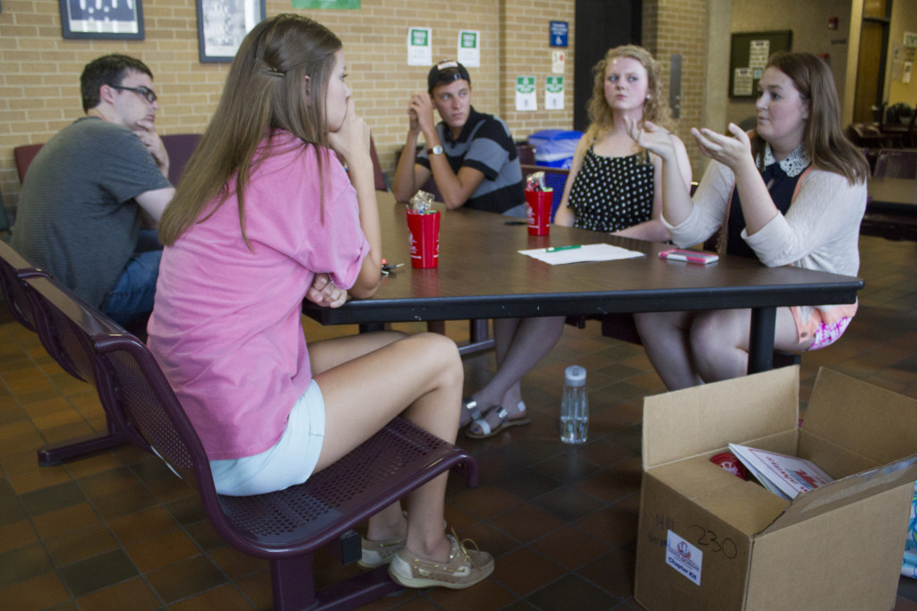 Political science senior and ​UNT's College Republicans group leader Emily Hennig speaks with new members about the organization's plans for the semester. Paulina De Alva | Staff Photographer