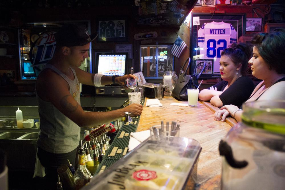 A bartender at Rip Rock's fixes drinks. | Paulina De Alva