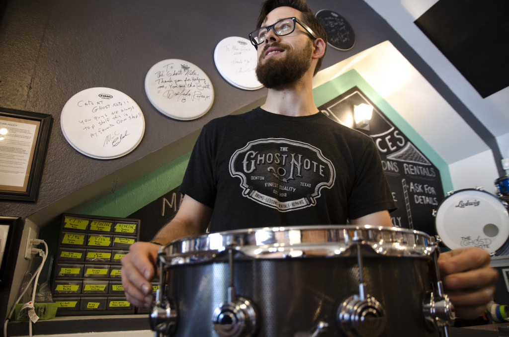 Colby Schreck, store owner and manager replaces a drum head on September 14, 2015.