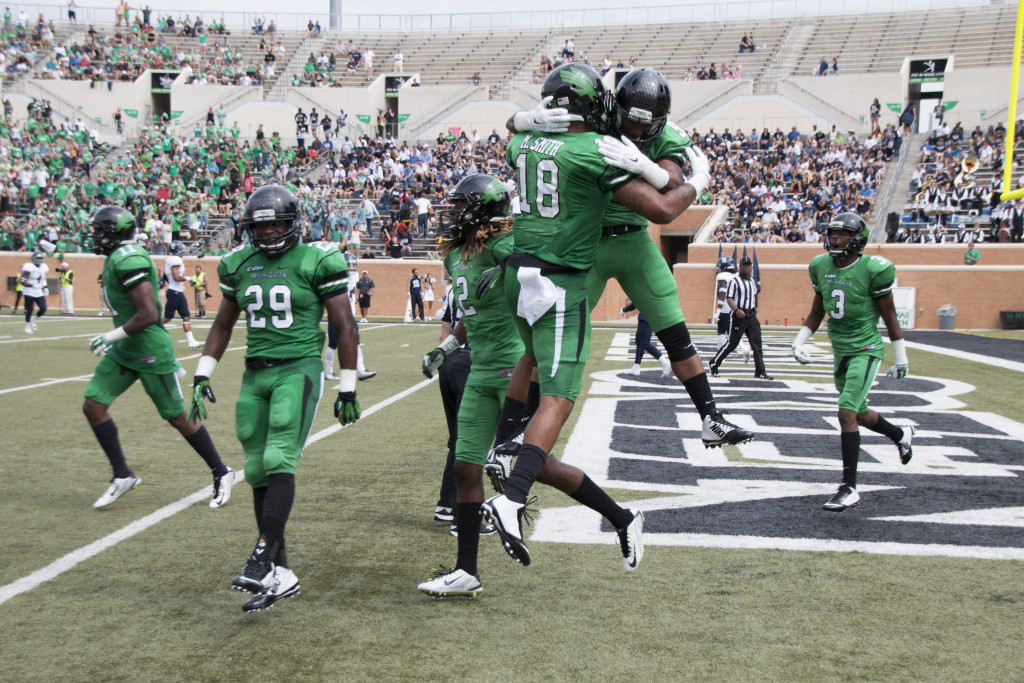 Senior wide reciever Carlos Harris and senior tight end Marcus Smith celebrate after Harris' touchdown against Rice on September 19th. Dylan Nadwodny | Intern Photographe