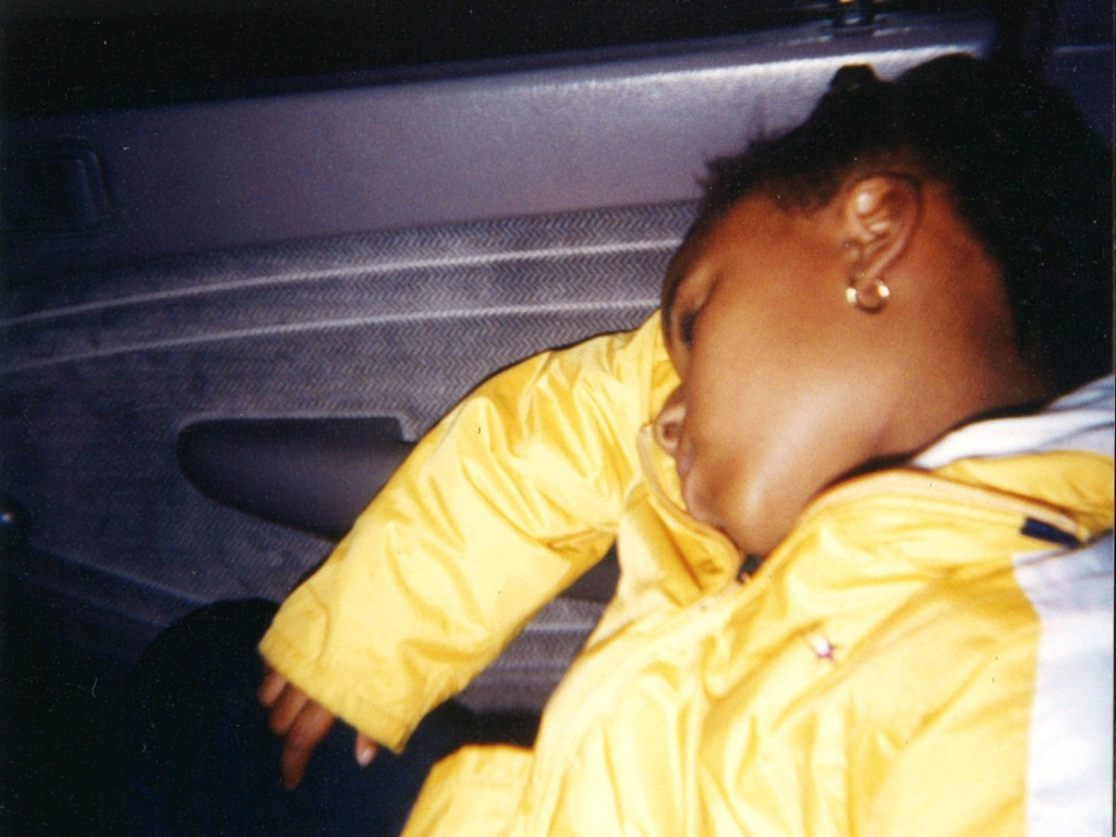 Trish Brooks' daughter, Maraida, who was 8 years old at the time, sleeps in the car as her and her family evacuate the New Orleans area ahead of Hurricane Katrina and head to Brooks' sister's home in Wylie.