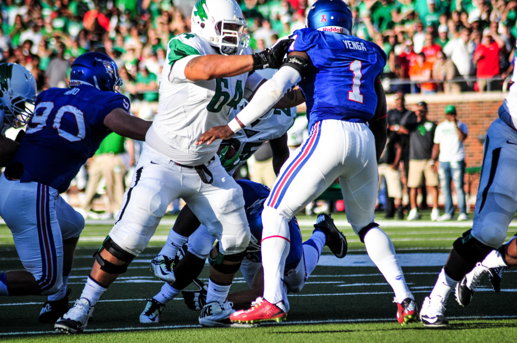 Offensive lineman Sam Rice blocks SMU running back Kevin Thomas.