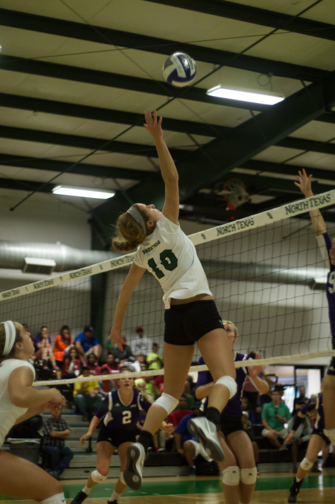 Holly Milliam goes airborne in Saturday morning's win against Abilene Christian.