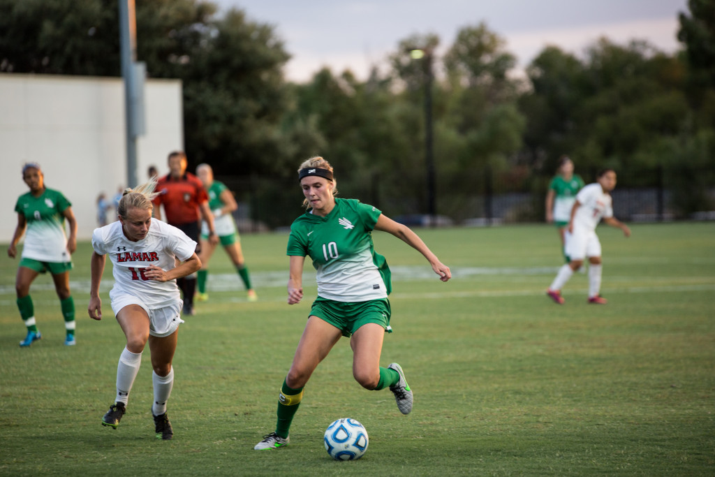 Senior Lindsey Hulstein steals the ball for the Mean Green.