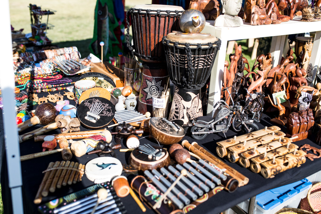 Ingrid Jaya's Made in Bali booth features wooden pieces and African drums.