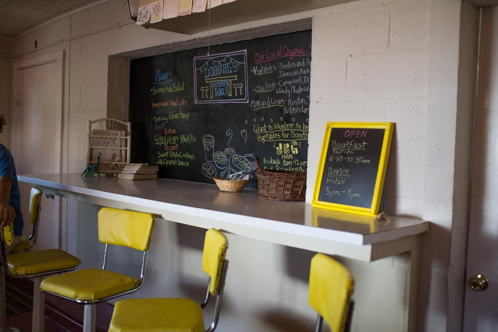A chalkboard behind the built-in bar advertises the meal of the day.