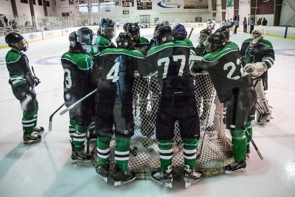 The UNT Ice Hockey Team talks at their net before facing off against Texas State on September 11th. Dylan Nadwodny | Intern Photographer