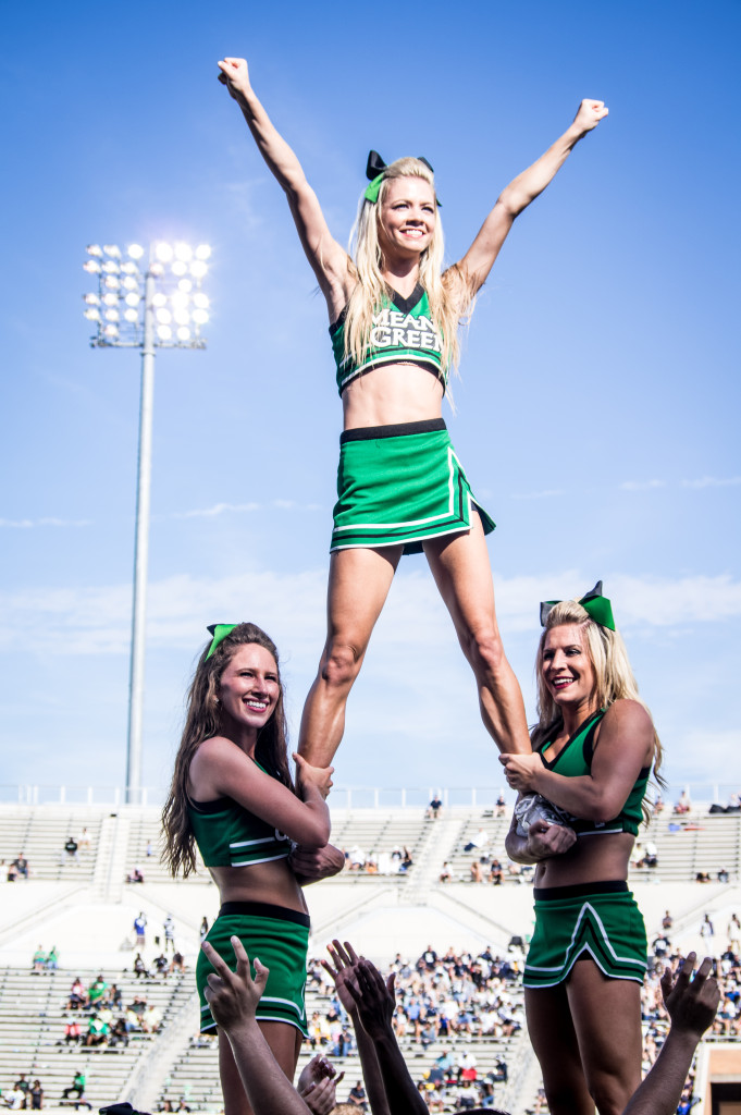 UNT Cheer keeps the energy up during Saturday's game against Rice.  Matthew Brown | Staff Photographer