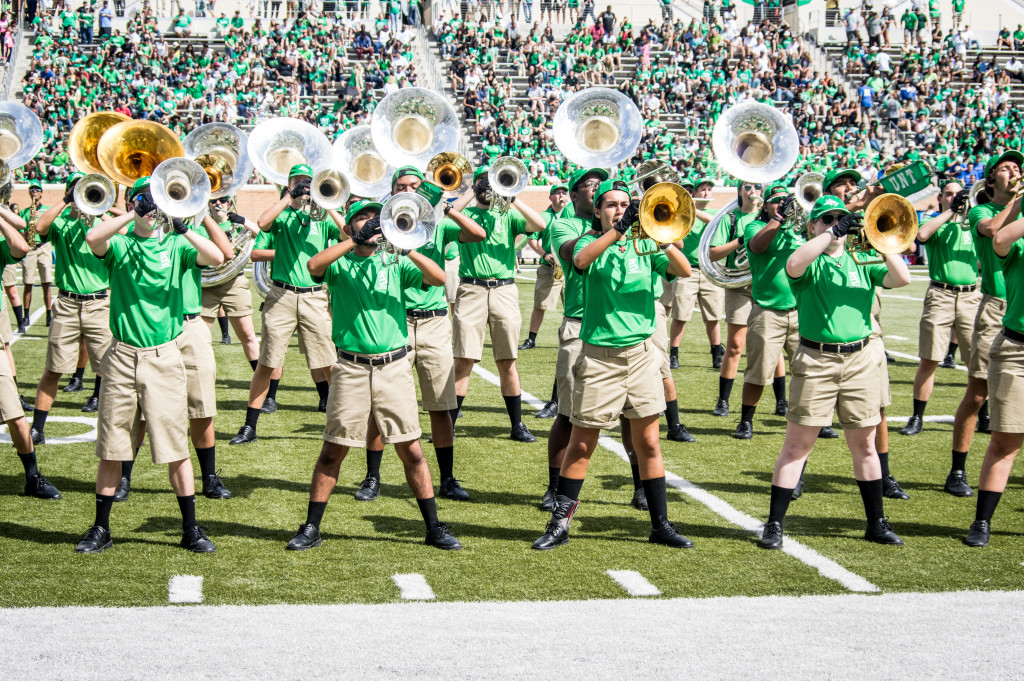 UNT's band kept fans in their seats with a great performance during the halftime show .  Matthew Brown | Staff Photographer