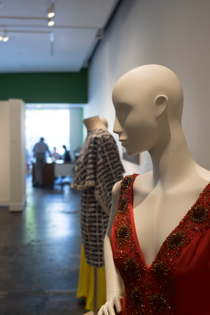A mannequin is graced with the Goldfish Red Dress by UNT Alum Lucy Dang in the Counter Narratives exposition at UNT on the Square. Matthew Brown | Senior Staff Photographer