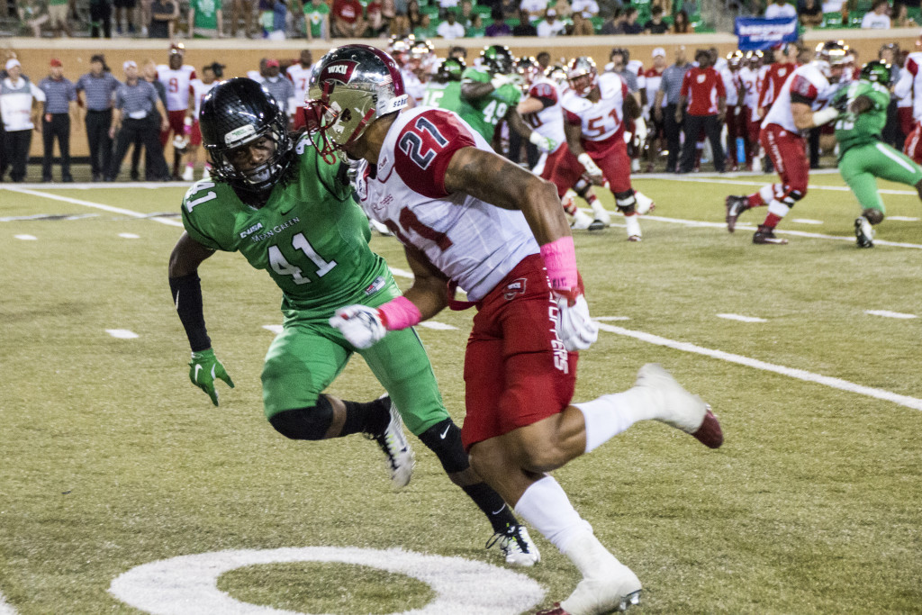 North Texas freshman defensive back Ashton Preston (41) defends against Western Kentucky's Jared Dangerfield (21) on October 15th, 2015. Dylan Nadwodny | Staff Photographer