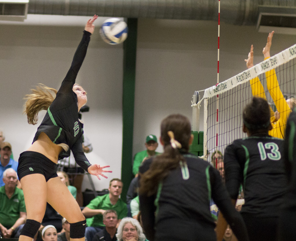 North Texas sophomore middle blocker Holly Milam (10) attempts to kill the ball. Colin Mitchell   Intern Photographer