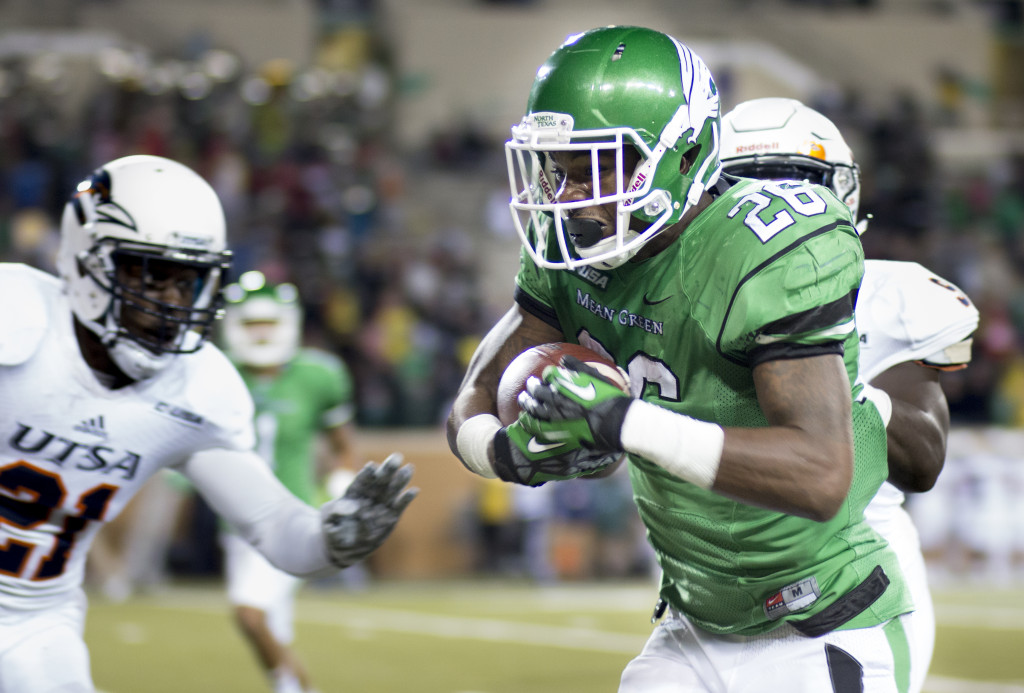 North Texas sophomore running back Jeffery Wilson (26) runs the ball out of bounds late in the game. Wilson had 135 yards on 22 carries against UTSA. Colin  Mitchell | Intern Photographer