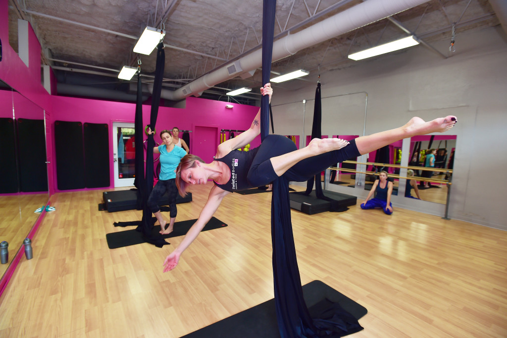 Twisted Bodies co-owner Khristen Pahler demonstrates a hip key hold during her class on Aerial Skills Monday October 5, 2015, in Denton, Tx. Photo by Al Key/DRC