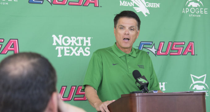 Interim head football coach Mike Canales meets the media