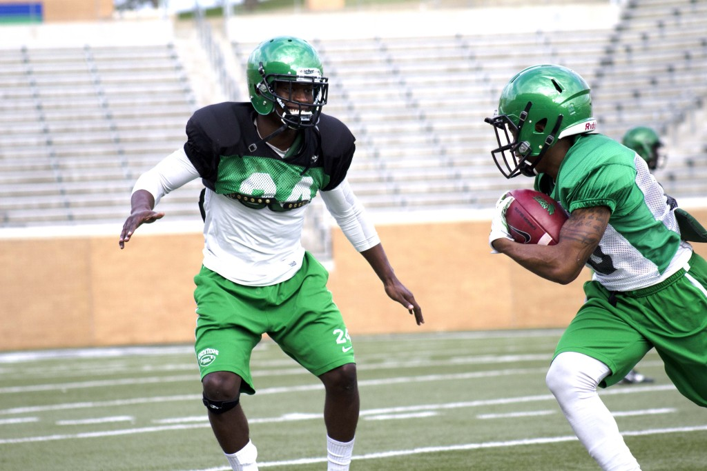 Zac Whitfield runs a practice play on Tuesday at Apogee Stadium. Though the Mean Green has had less than a stellar season, they push through and practice regularly.  Brittany Sodic | Staff Photographer