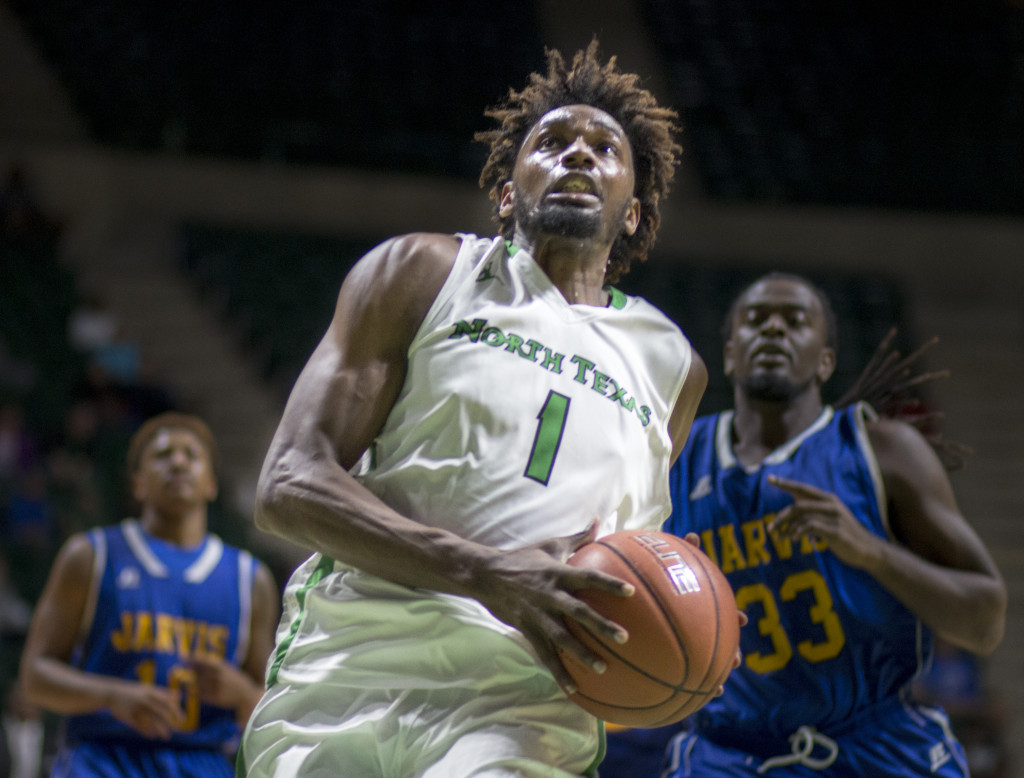 North Texas sophomore forward Jeremy Combs (1) jumps toward the hoop for an uncontested dunk against Jarvis Christian. Colin Mitchell | Intern Photographer