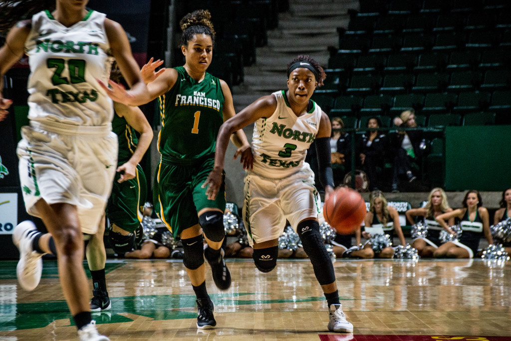 North Texas junior guard Kelsey Criner (3) works around a San Fransisco defender during Friday night's game. Dylan Nadwodny | Staff Photographer