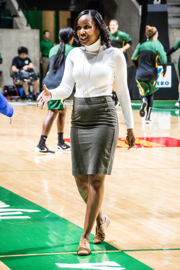 North Texas women's basketball assistant coach Aisha Stewart introduces her self to a San Fransisco coach on November 12, 2015. Dylan Nadwodny   Staff Photographer