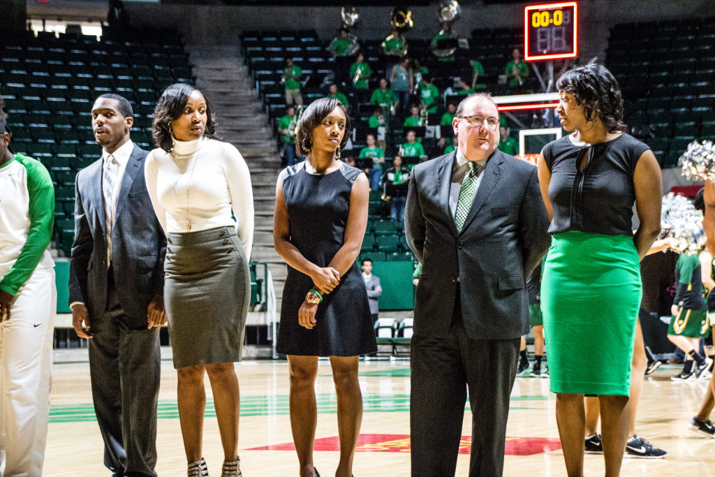 From left to right, Joshua Franklin, Aisha Stewart, Kasondra Foreman, and Jalie Mitchell, stand before the national anthem is played on November 12, 2015. Dylan Nadwodny  Staff Phtographer