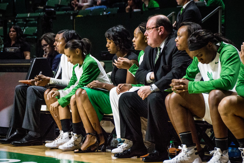 The North Texas women's basketball coaching staff watches the team in the first quarter of Thursday's game against San Fransisco. Dylan Nadwodny   Staff Photographer