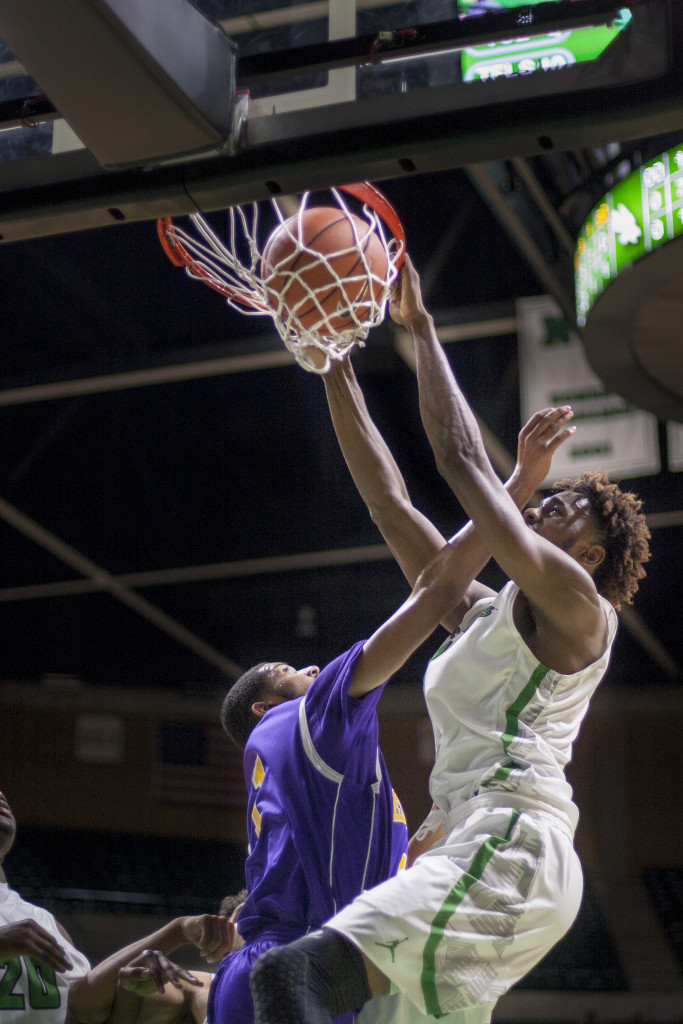 North Texas freshman center Rickey Brice (23) dunks the ball to push the Mean Green past 100 points against Jarvis Christian. Colin Mitchell | Intern Photographer