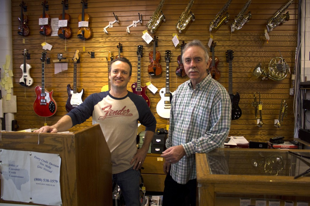 Glen's Pawn Shop guitar tech Dave Hineman, left, and owner Glen McBride, left, stand proud in their shop on University Drive. Paulina De Alva | Staff Photographer